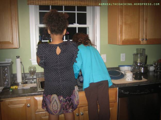 Two of my nieces washing dishes after a big family party.