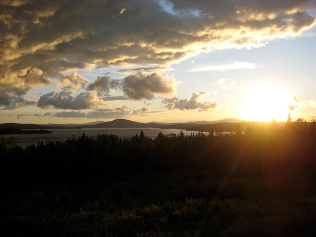 A beautiful sunset can help me feel happy! This one is from a trip in 2010 to Rangeley, Maine.