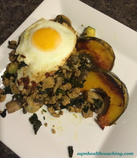 Ground Turkey hash with kale, zucchini, mushrooms and onions, served with baked kabocha squash and a fried egg