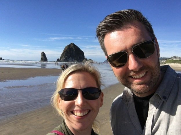 Me and John at Haystack Rock, Cannon Beach, OR. We had hot temps and did a ton of walking early in our trip and my heat/exercise disliking husband didn't complain even once. Trying on a new version of ourselves!